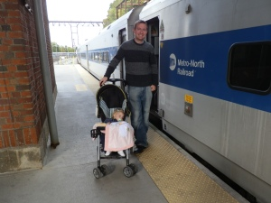 I stand with my daughter, sleeping in her stroller, and the Metro-North train that took us to the end of the Hudson Line in Poughkeepsie, New York, on 22 October 2011. My daughter had just turned 1 a few months earlier.