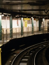 The curved outer track and platform of the loop station, which was designed to allow terminating downtown trains to return to the uptown track.
