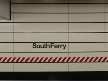 The station's name emblazoned on the wall. This is one of the few changes to the station that resulted from the post-Sandy restoration and repair. Originally the station names on the walls were significantly smaller. The new lettering reflects the lettering and sizing on other new stations in the New York City Subway system.