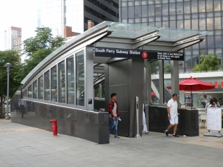The most significant architectural and structural changes to the station can be found on the surface, where redesigned station entrances can be sealed off to protect the station from floodwaters. This entrance is in Peter Minuit Plaza, in front of the Staten Island Ferry's Whitehall Terminal.