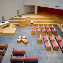 A view of the sanctuary from street level — the floor of the sanctuary is actually one level below ground — reveals the simple geometry and modern lines and materials that define the church's design.