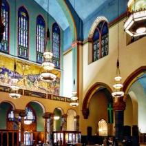 A view toward the narthex and the southeast corner of the nave reveals more of the church's interior, which is an intriguing mix of color, light, and dark.