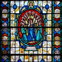 A stained-glass window in the west wall of the sanctuary.