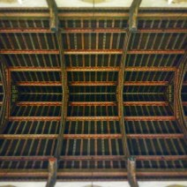 Timber ceiling with stenciling over the nave.