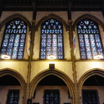 Arcade over the south aisle and with stained-glass windows in the clerestory above.