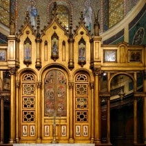 """The choir screen or reredos. At Christ Church, the altar is in front of the screen, though in Eastern Orthodox churches — whose artistic influence is clearly seen in this design — the screen, called an iconostasis, separates lay congregants in the nave from the altar in the apse. In some Orthodox traditions only the priest may pass the screen; in others, lay people may pass using the side doors, but only the priest can use the center doors. (I had the opportunity to go through the side doors of an iconostasis at the Russian Orthodox Cathedral of the Transfiguration of Our Lord in Greenpoint, Brooklyn, back in February 2018.) According to a church brochure, the center doors here, off the ground above the altar, """"originated in a Russian Orthodox church, circa 1660. Through accidents of history they found their way into the private collection of czar Nicholas II before being purchased by Christ Church member Juliet Thompson and donated to the church in the mid-1930s."""""""
